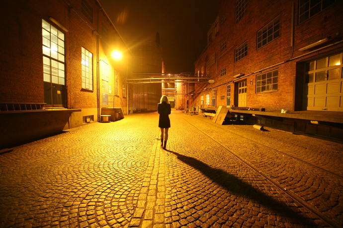 1586779417 back view photo of woman walking alone in the middle of a 2488525